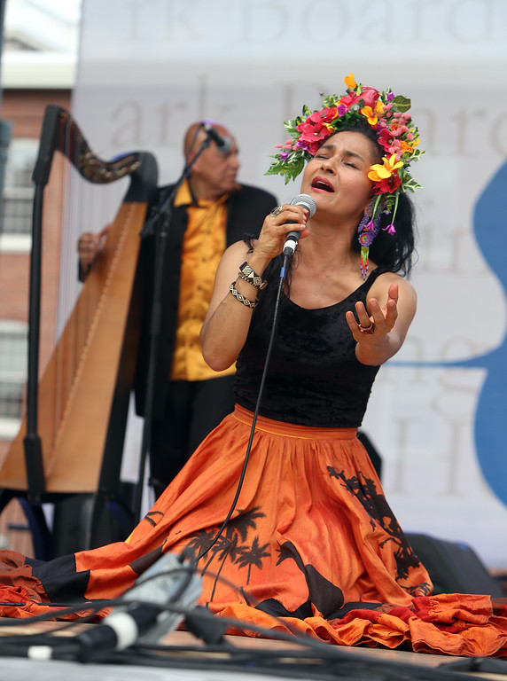 . Saturday at Lowell Folk Festival. Ana Veydo sings as Grupo Cimarron perform Colombian joropo music. (SUN/Julia Malakie)