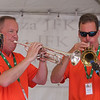 Saturday at Lowell Folk Festival. Paul Chmil, left, and Jeff Teufel, both on trumpet, of the John Stevens Polka Band at JFK Plaza.  (SUN/Julia Malakie)