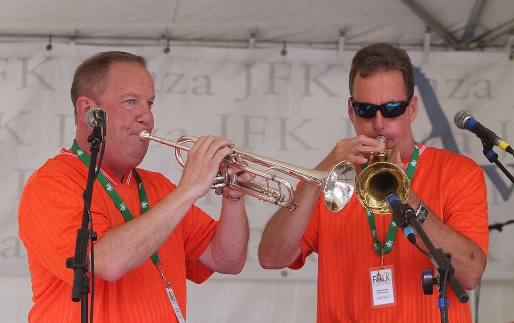 . Saturday at Lowell Folk Festival. Paul Chmil, left, and Jeff Teufel, both on trumpet, of the John Stevens Polka Band at JFK Plaza.  (SUN/Julia Malakie)