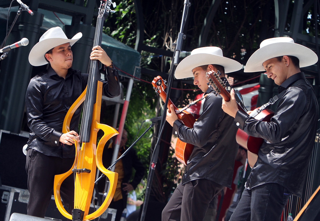. Saturday at Lowell Folk Festival. Grupo Cimarron performs Colombian joropo music at Boarding House Park. (SUN/Julia Malakie)