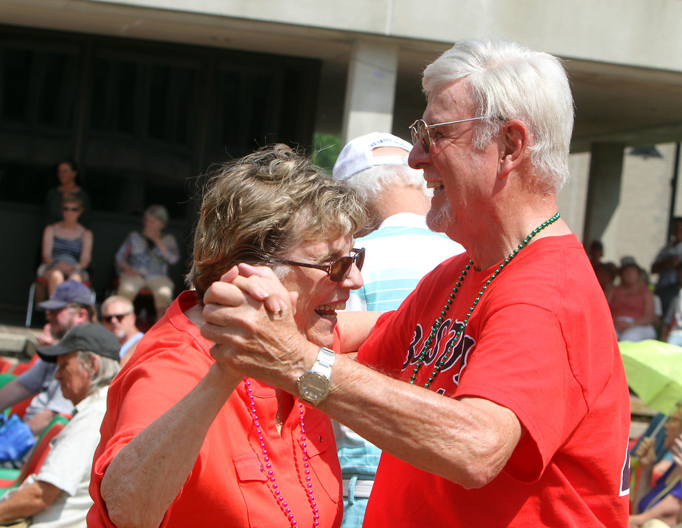 . Saturday at Lowell Folk Festival. Sandy Thibault and Ed Duchesne, both of Hudson, N.H., dance to music of the John Stevens Polka Band at JFK Plaza.  (SUN/Julia Malakie)