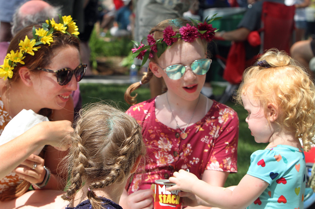. Saturday at Lowell Folk Festival. Clockwise from left, Katie McEwan of Clinton, Prudence Correia, 10, and his sister Penelope Correia, 2, of Chelmsford, and Reese Hegarty, 2, of Lowell, at JFK Plaza.  (SUN/Julia Malakie)