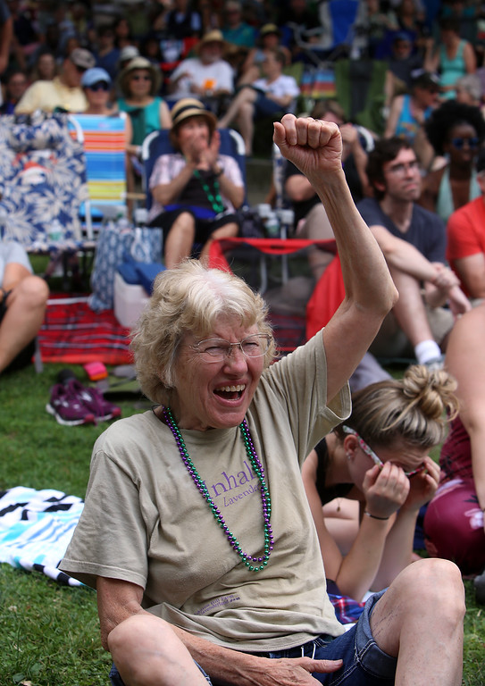 . Saturday at Lowell Folk Festival. Susan Hansen of Cheshire, Mass., cheers Grupo Cimarron at Boarding House Park. (SUN/Julia Malakie)