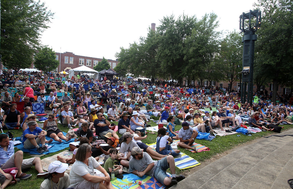 . Saturday at Lowell Folk Festival. Audience at Boarding House Park listens to Grupo Cimarron perform Colombian joropo music. (SUN/Julia Malakie)