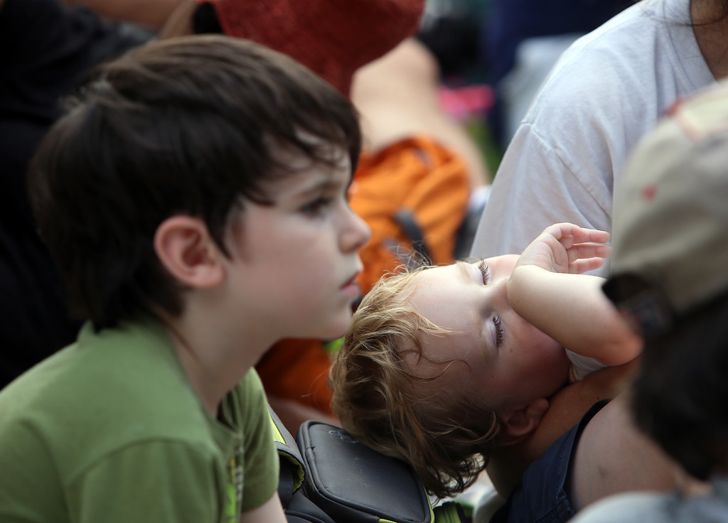 . Saturday at Lowell Folk Festival. Geroge Bolden, 6, and his sleepy brother Cormac Bolden, 2, of Lowell, at Boarding House Park during performance of Grupo Cimarron. (SUN/Julia Malakie)