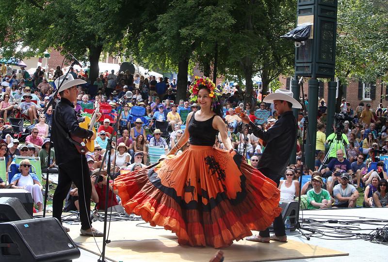 Saturday at Lowell Folk Festival. Ana Veydo sings and dances as Grupo Cimarron perform Colombian joropo music at Boarding House Park. (SUN/Julia Malakie)
