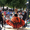 Saturday at Lowell Folk Festival. Ana Veydo sings and dances as Grupo Cimarron perform Colombian joropo music at Boarding House Park. (SUN/Julia Malakie)
