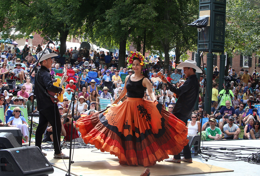 . Saturday at Lowell Folk Festival. Ana Veydo sings and dances as Grupo Cimarron perform Colombian joropo music at Boarding House Park. (SUN/Julia Malakie)