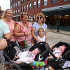 Saturday at Lowell Folk Festival. Alec and Katie Belanger of Billerica with their 6-month-old triplets, from left, Emelia, Violet and Stella, daughter Gabby, 9, and the girls' grandmothers Deb Belanger of Lowell and Patty Zediana of Billerica, right. (SUN/Julia Malakie)