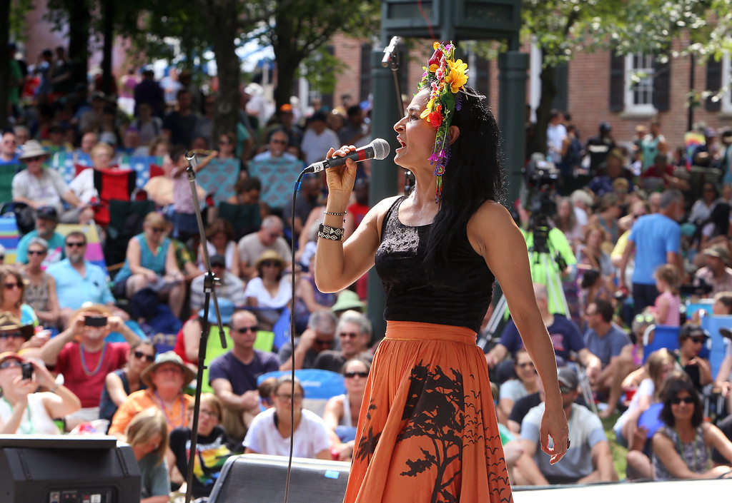 . Saturday at Lowell Folk Festival. Ana Veydo sings as Grupo Cimarron perform Colombian joropo music at Boarding House Park. (SUN/Julia Malakie)
