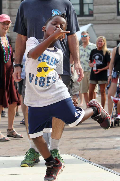 . Shawn Matovu, 5, of Beverly, dances to Cajun music of the Dixie Club Ramplers at JFK Plaza. (SUN/Julia Malakie)