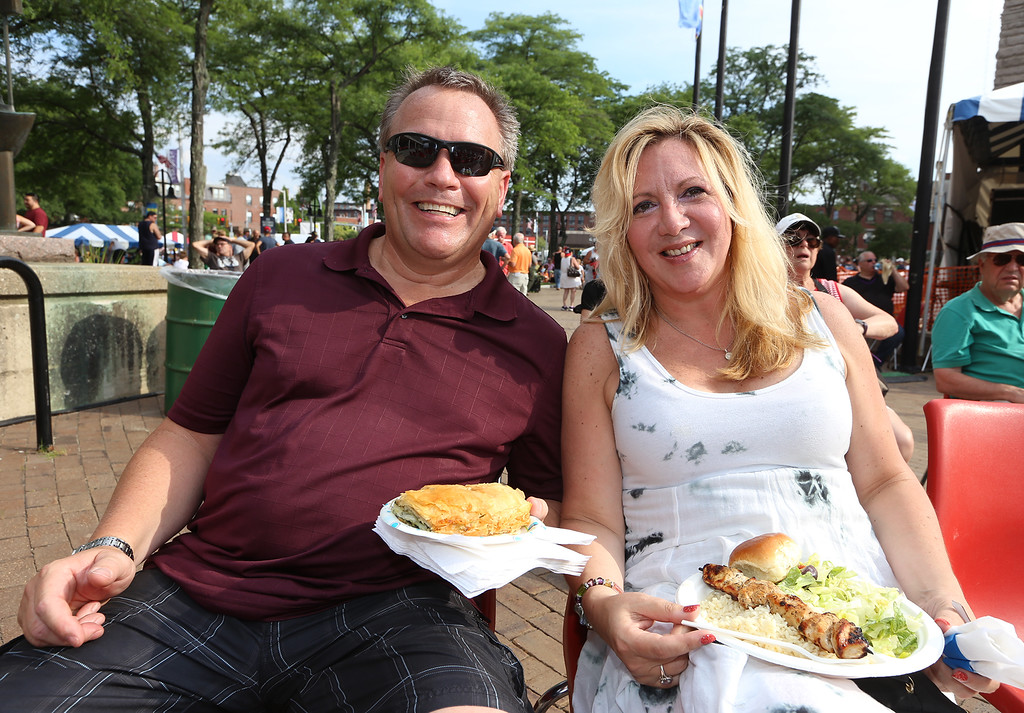 . Lowell Folk Festival. Scotto Gage and Dixie Richards of Tyngsboro with Greek food at JFK Plaza. (SUN/Julia Malakie)