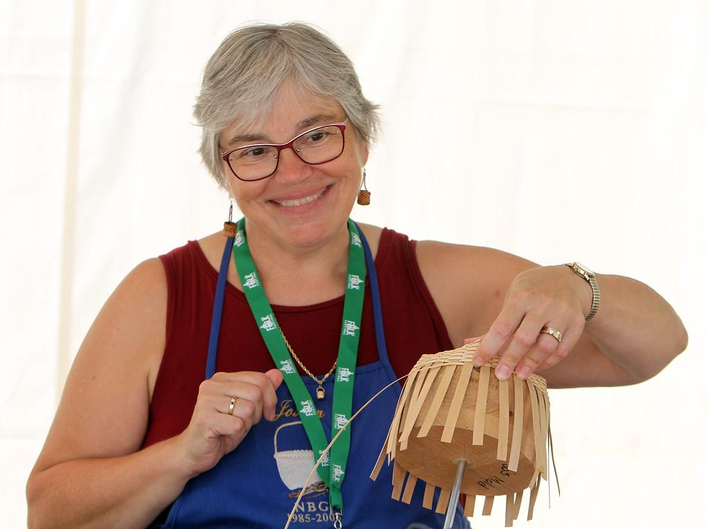 . Lowell Folk Festival. Finnish birch bark basketmaker Elaine Moe of Millers Falls. (SUN/Julia Malakie)
