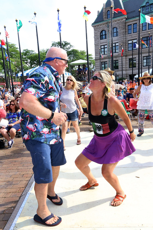 . Lowell Folk Festival. John Pugh of Tyngsboro and Aileen Dashurova of Westford dance to Cajun music of Kyle Huval & the Dixie Club Ramplers at JFK Plaza. (SUN/Julia Malakie)
