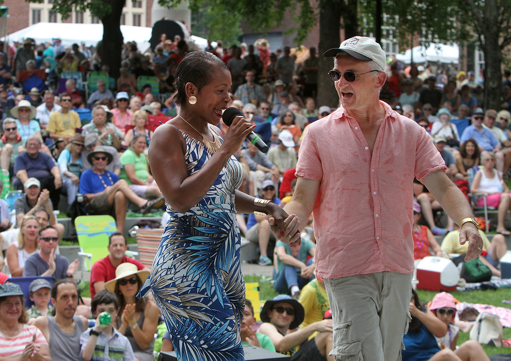 . Lowell Folk Festival. Cabo Verdean singer Neuza pulls Steve Roberson of Holliston from the audience to dance on stage. (SUN/Julia Malakie)