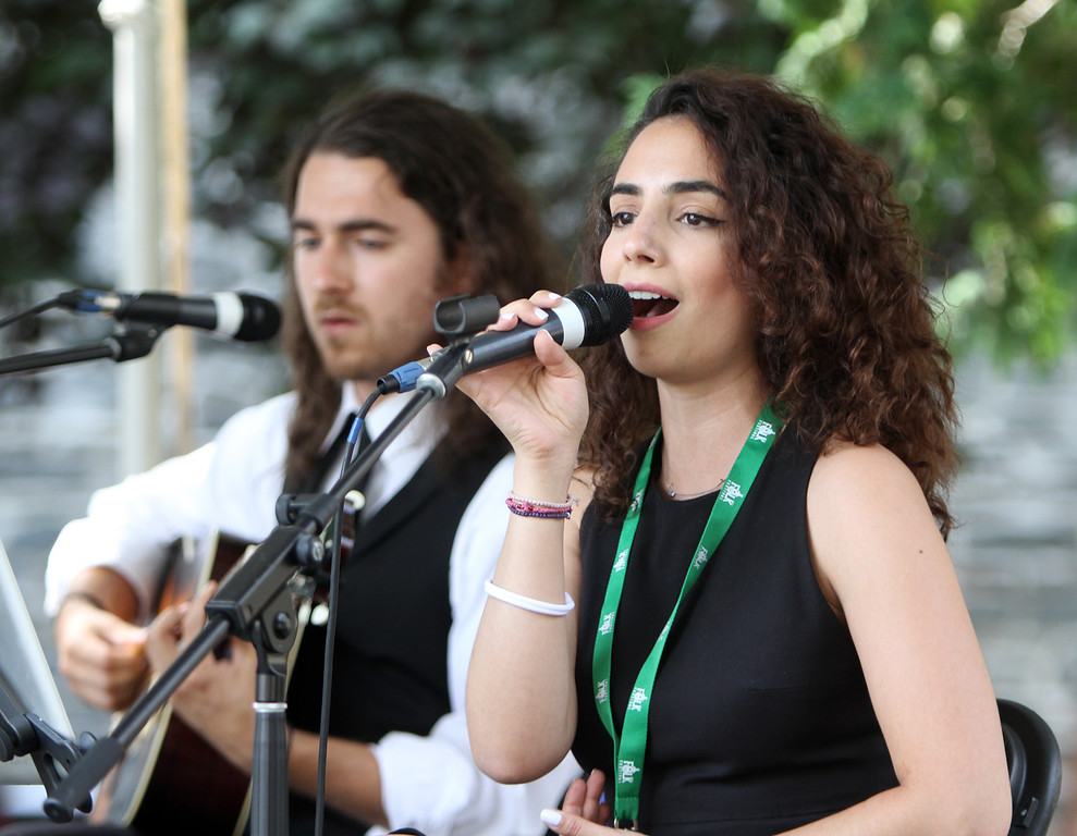 . Lowell Folk Festival. Singer Andrea Charles and classical guitarist Taso Comanescu perform with Greek Rebetiko Trio at St. Anne\'s Churchyard.(SUN/Julia Malakie)