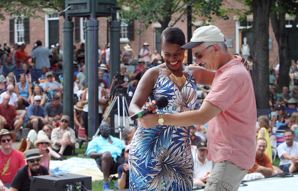 . Lowell Folk Festival. Cabo Verdean singer Neuza dances with Steve Roberson of Holliston, a volunteer she pulled from the audience. (SUN/Julia Malakie)