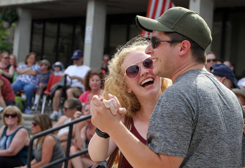 . Lowell Folk Festival. Grace Henderson of Sudbury and her boyfriend Chris Bogan of Dracut dance to Cajun music of the Dixie Club Ramplers at JFK Plaza. (SUN/Julia Malakie)