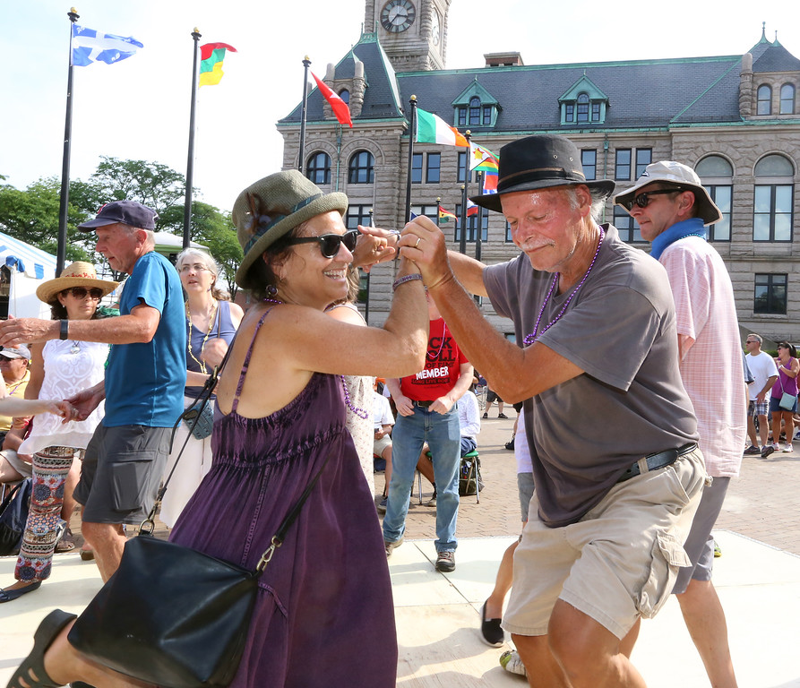 . Lowell Folk Festival. Angela Masciale and her husband Daniel Zampino of Marblehead dance to Cajun music of Kyle Huval & the Dixie Club Ramplers at JFK Plaza. Masciale said they\'ve come to every Lowell Folk Festival since 1986. (SUN/Julia Malakie)
