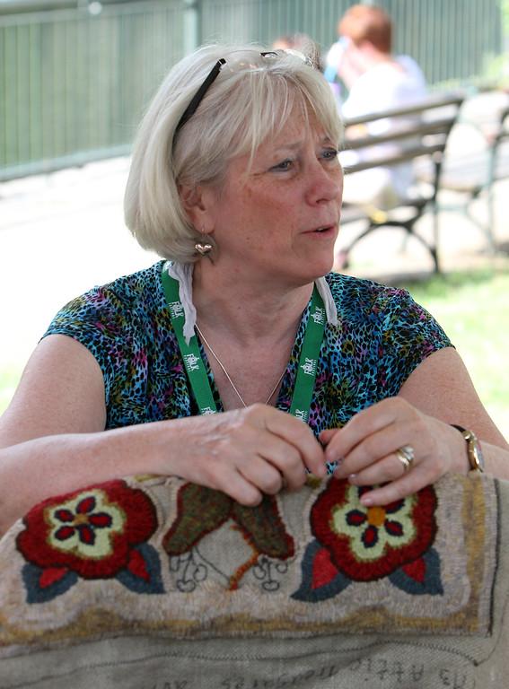 . Lowell Folk Festival. Rug hooker Pam Bartlett of Loudon, N.H. (SUN/Julia Malakie)