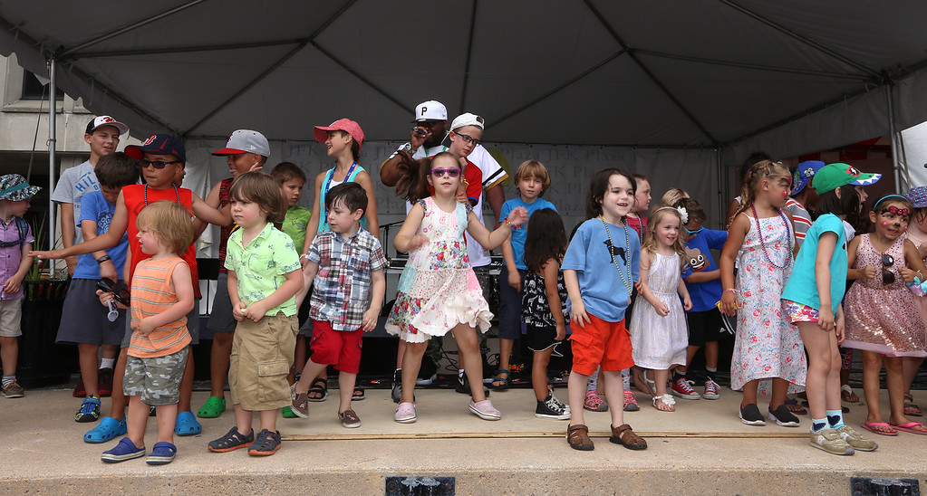 . Lowell Folk Festival. Beatboxing master Rahzel, center rear, invites kids onstage to dance at JFK Plaza. (SUN/Julia Malakie)