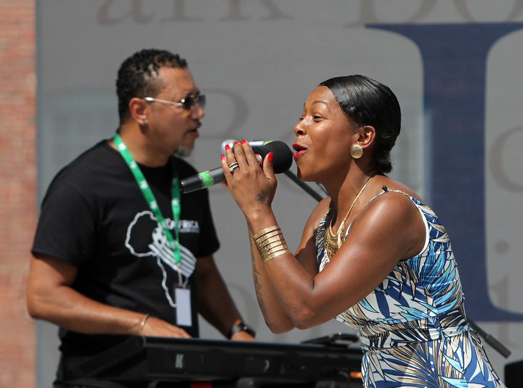 . Lowell Folk Festival. Cabo Verde singer Neuza performs at Boarding House Park. (SUN/Julia Malakie)