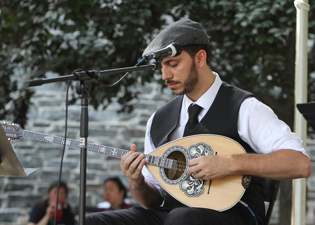 . Lowell Folk Festival. Bouzouki player Dimitris Mann performs with the Greek Rebetiko Trio at St. Anne\'s Churchyard. (SUN/Julia Malakie)