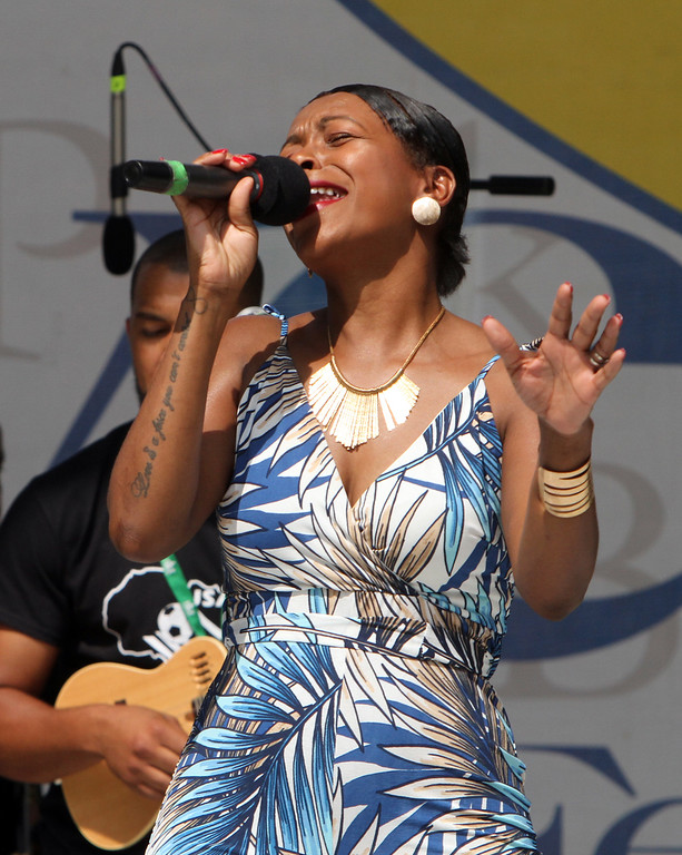 . Lowell Folk Festival. Cabo Verdean singer Neuza performs at Boarding House Park. (SUN/Julia Malakie)
