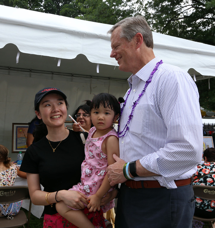 . Lowell Folk Festival. Siyu Chang of Cambridge poses for photo with Gov. Charlie Baker. (SUN/Julia Malakie)