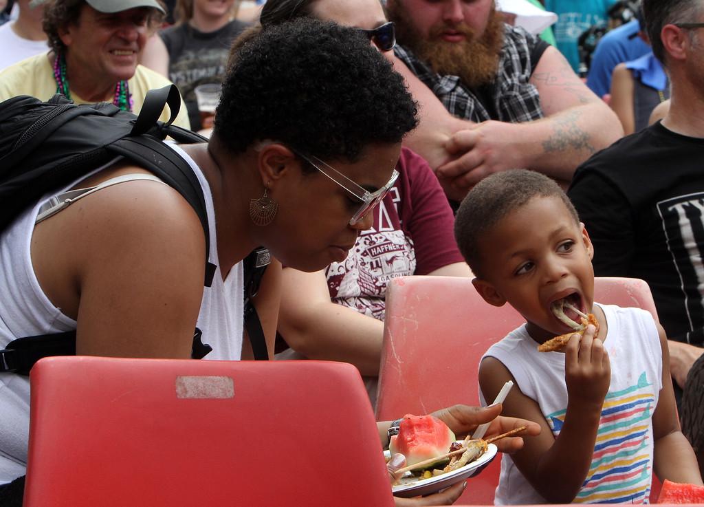 . Lowell Folk Festival. Aleksandra and son Ellis Tugbiyele, 4, of Lowell, at JFK Plaza. (SUN/Julia Malakie)
