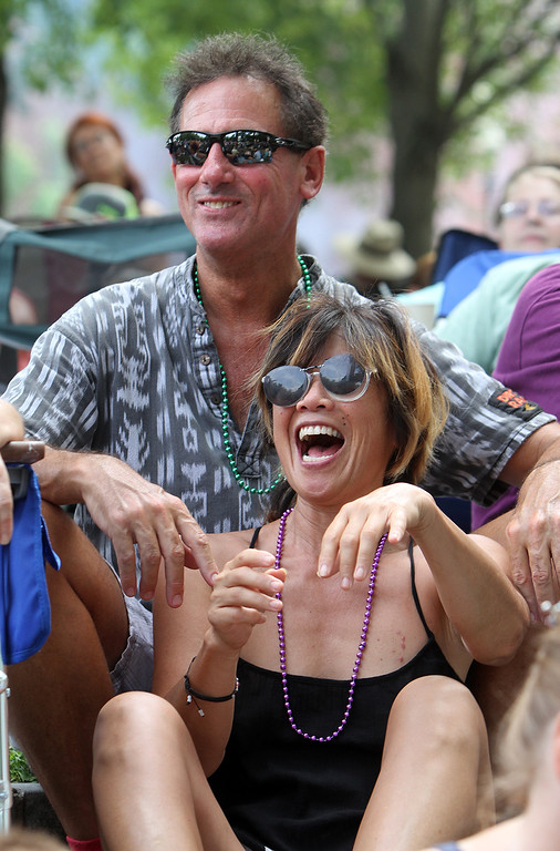 . Lowell Folk Festival. Gloria Gilbert and her boyfriend Philip Keyes, both of Acton, enjoy the Cabo Verde singing of Neuza at Boarding House Park. (SUN/Julia Malakie)