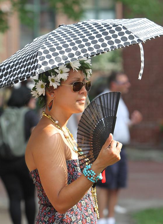 . Lowell Folk Festival. Ruby Carnevale of Lowell stays cool at Market Street Stage. (SUN/Julia Malakie)