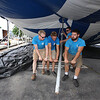 Workers from Commercial Tent Rentals in New Brunswick set up the tent for the Dutton Street Dance Pavilion. From left, Joe Potter, Kevin Westerberg, and Carter McCandless (rear), all of Sussex, N.B., and Tim Levy of Norton, N.B., pull a support pole in place to raise the tent. (SUN/Julia Malakie)