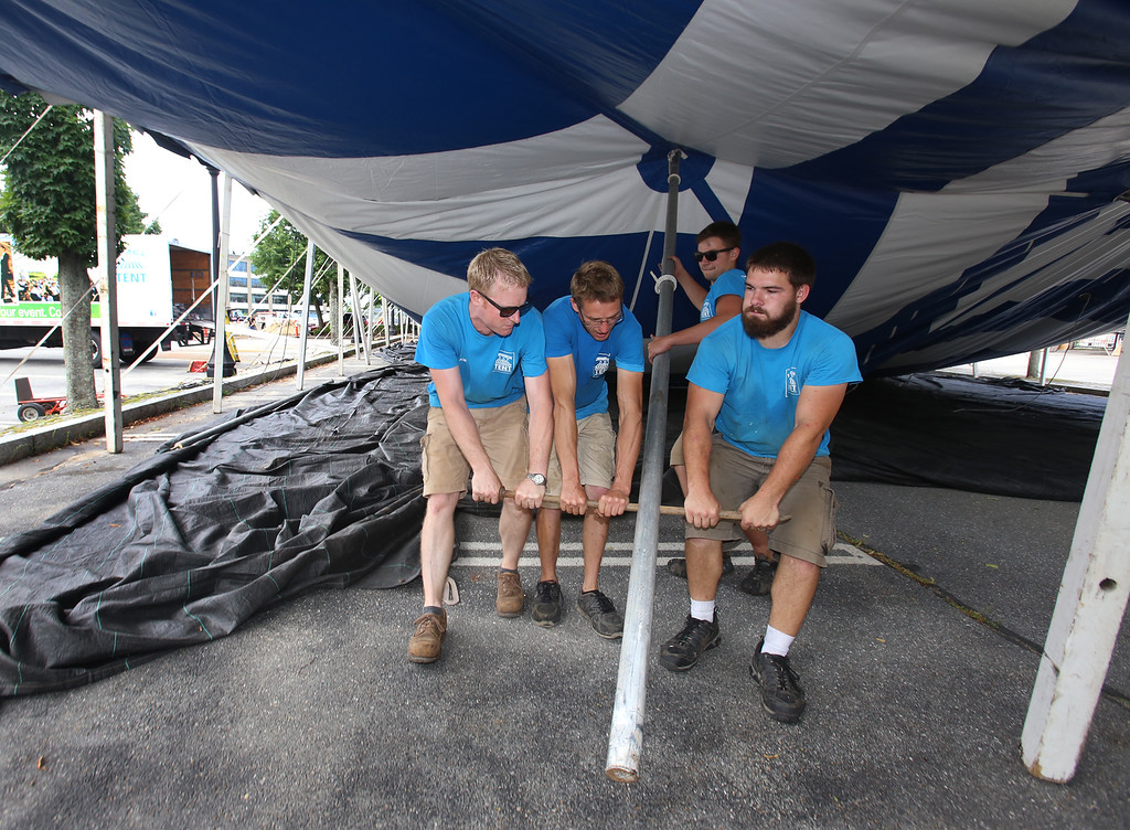 . Workers from Commercial Tent Rentals in New Brunswick set up the tent for the Dutton Street Dance Pavilion. From left, Joe Potter, Kevin Westerberg, and Carter McCandless (rear), all of Sussex, N.B., and Tim Levy of Norton, N.B., pull a support pole in place to raise the tent. (SUN/Julia Malakie)