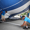 Workers from Commercial Tent Rentals in New Brunswick set up the tent for the Dutton Street Dance Pavilion. Clockwise from left, Kevin Westerberg, Carter McCandless (rear), and Joe Potter (right rear), all of Sussex, N.B., and Tim Levy of Norton, N.B., right front. (SUN/Julia Malakie)