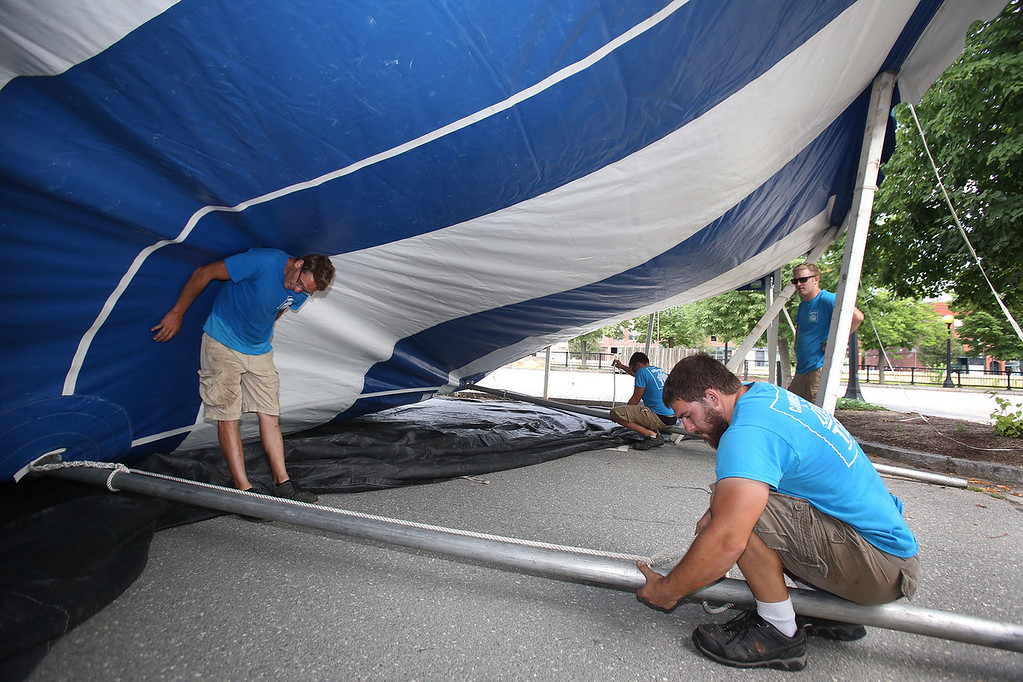 . Workers from Commercial Tent Rentals in New Brunswick set up the tent for the Dutton Street Dance Pavilion. Clockwise from left, Kevin Westerberg, Carter McCandless (rear), and Joe Potter (right rear), all of Sussex, N.B., and Tim Levy of Norton, N.B., right front. (SUN/Julia Malakie)