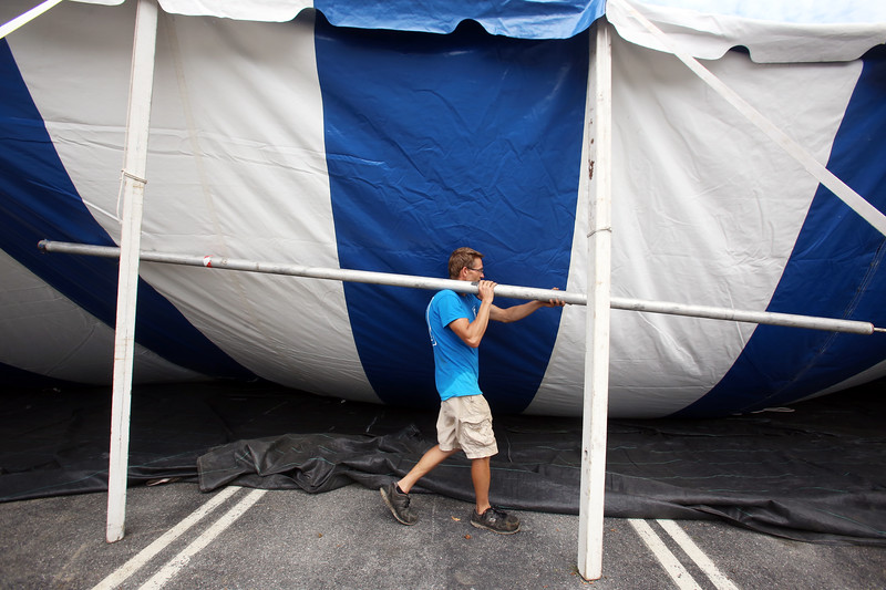 Workers from Commercial Tent Rentals in New Brunswick set up the tent for the Dutton Street Dance Pavilion.  Kevin Westerberg of Sussex, N.B., moves support poles. (SUN/Julia Malakie)