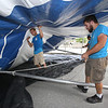 Workers from Commercial Tent Rentals in New Brunswick, Kevin Westerberg of Sussex, N.B., left, and Tim Levy of Norton, N.B., right, set up the tent for the Dutton Street Dance Pavilion.  (SUN/Julia Malakie)