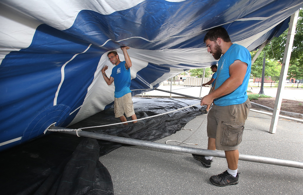 . Workers from Commercial Tent Rentals in New Brunswick, Kevin Westerberg of Sussex, N.B., left, and Tim Levy of Norton, N.B., right, set up the tent for the Dutton Street Dance Pavilion.  (SUN/Julia Malakie)