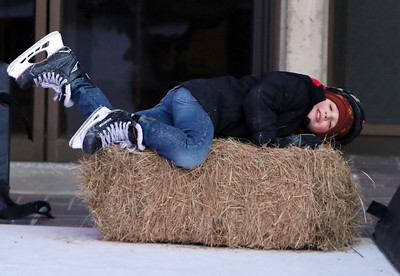 Opening night of Lowell WinterFest 2020. John Graceffa, 6,  of Lowell, lands on a hay bales while skating on the artificial ice at JFK Plaza. (SUN/Julia Malakie)