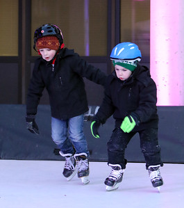 Opening night of Lowell WinterFest 2020. John Graceffa, 6, and his brother Luke Graceffa, 5, of Lowell, skate on the artificial ice at JFK Plaza. (SUN/Julia Malakie)
