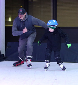 Opening night of Lowell WinterFest 2020. Chris Graceffa of Lowell skates with his son Luke Graceffa, 5, on the artificial ice at JFK Plaza. (SUN/Julia Malakie)