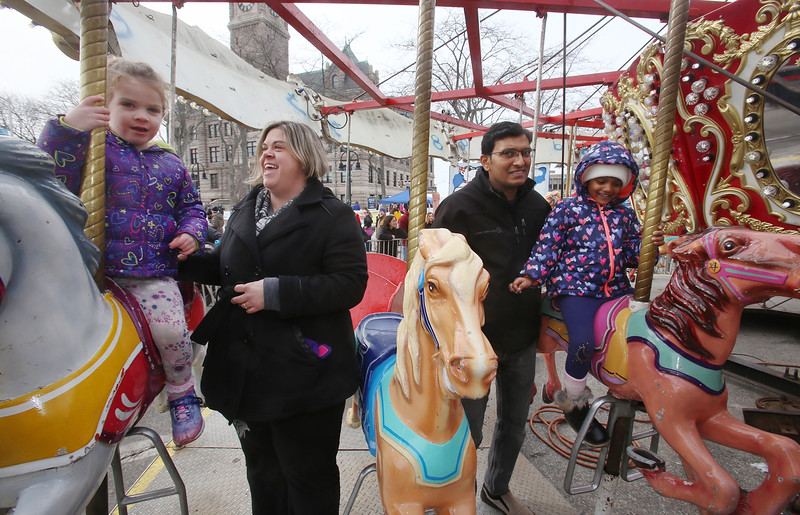 2019 Lowell Winterfest. Adelyn Ross, 3, and her mother Nicole Ross of Lowell, left, and Krisha Vijayakumar, 4, and her father Vijayakumar Vaddarrajappa of Andover, right. (SUN Julia Malakie)