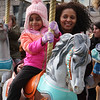 2019 Lowell Winterfest. Lulya Sengal, 5, of Somerville, on merry-go-round with her aunt Netsanet Tadesse of Lowell. (SUN Julia Malakie)
