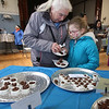 2019 Lowell Winterfest. Brenda Lewis of Methuen and her granddaughter Leah Couture, 8, of North Andover, at the Chocolate Festival at St. Anne's Church. (SUN Julia Malakie)