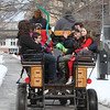 2019 Lowell Winterfest. Team of Black Percherons from Charmingfare Farm in Candia, N.H., pull a carriage around a loop through Lucy Larcom Park and Kirk Street. (SUN Julia Malakie)