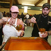 2019 Lowell Winterfest. Stonehedge Inn front desk rep Meaghan McCartin of Dracut and sous chef Jakob Norse of Lowell, pour servings of NoLo Bistro & Bar's Smoked Tomato Bisque at the Richard Rourke Memorial Soup Bowl Competition. (SUN Julia Malakie)