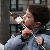Emory Cromwell, 4, of Lowell, eats a toasted marshmallow at 2019 Lowell Winterfest. (SUN Julia Malakie)