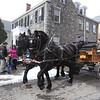 2019 Lowell Winterfest. Team of Black Percherons from Charmingfare Farm in Candia, N.H., Stacy, left, and Emma, right, pull a carriage around a loop through Lucy Larcom Park and Kirk Street. (SUN Julia Malakie)