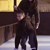 Lowell Winterfest opening night. Selena Phang, 18, and her nephew Toby Bong, 5, both of Lowell, skate on the artificial ice at the Civic Center. (SUN Julia Malakie)
